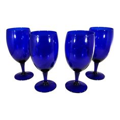 Beautiful set of 4 cobalt blue goblet stemware. Large goblets for water, wine or cocktails! Add elegance and dramatic color to your table! Color is a deep, dark cobalt blue. Condition is very good, no cracks or chips. Cobalt Glass, Turquoise Glass, Cobalt Blue Kitchens, Blue Wine Glasses, Blue Dishes, Vintage Dinnerware, Fenton Glass, Antique Glass, Ocean Deep