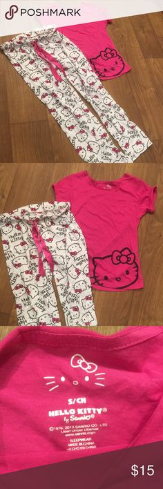 Hello kitty pajama set super cute size small! Hello kitty pajama set super cute size small! Hot pink t shirt is size small and pajama pants have hello kitty print and also small. Worn once in wonderful condition! Make me an offer! Hello Kitty Intimates & Sleepwear Pajamas