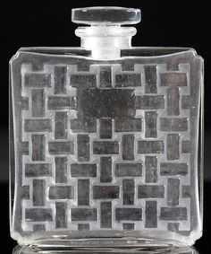 Perfume bottle by Lalique.