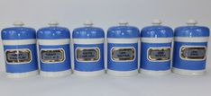 Six powder blue glass label apothecary drug jars.  C1900/10