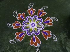 Very simple flower  kolam with colour in free hand style
