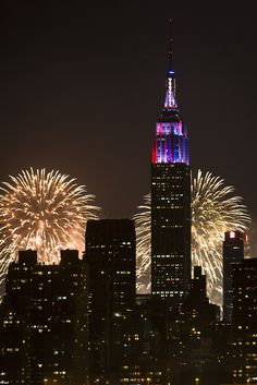 The Empire State was lit up as fireworks burst behind it in the spectacular light show. July 4, 2013