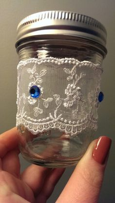 Rustic Wedding Theme...Antique lace and blue saphire mason jars... I made myself!!!