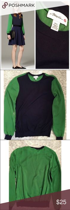 3.1 Phillip Lim for Target sweater 3.1 Phillip Lim for Target navy sweater front (61% rayon/ 31% nylon) with lightweight 'silky' green sleeves and back (100% polyester). Excellent condition! 3.1 Phillip Lim for Target Sweaters Crew & Scoop Necks