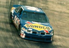 Sterling Marlin driving the Sunoco Oldsmobile hard through the turn.