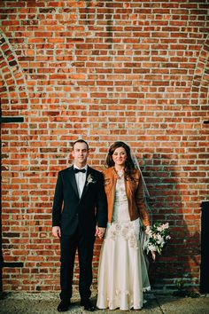 Love this bride's leather jacket | http://www.weddingpartyapp.com/blog/2014/10/06/hip-brooklyn-wedding-by-lev-kuperman/
