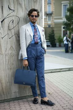 From Milan Fashion Week: Mr. Raro spotted on the street wearing his own brand, Mararo. Photo by Sophie Elgort