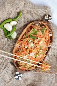 This Green Papaya Salad is also called as Som Tum/Tam salad. This is a very easy to make and delicious in taste. It is very crunchy, tangy, spicy and garlicky flavorful. Green Papaya Salad is a beautifully unique and flavor-filled dish that will make a great impression. It's also low-calorie, and very nutritious.