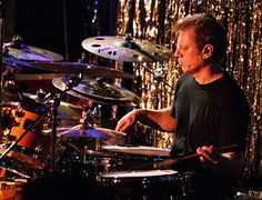 Dave Weckl Band.  Kick ass fusion jazz.  Influenced by Buddy Rich, Dave's drumming creates a big band sound from a mere quartet.  Try http://spoti.fi/wB5coH