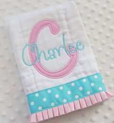BuRP CLoTH with appliqued initial AND personalized embroidery with baby girl's name - Pink and Turquoise. $11.99, via Etsy.