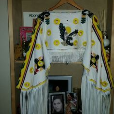 Sadly I took this Womans Traditional Cape apart to try bead it. In the process of putting humpty back together again.