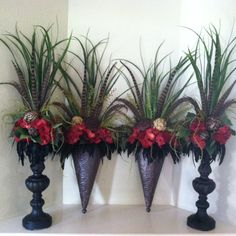 Coordinating silk floral arrangements, mantel arrangements, wall sconces in red. By Greatwood Floral Designs.