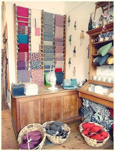 Selvedge Shop London : baskets & ladders imagine this for fabric storage. Scarf Storage, Fabric Storage, Ladder Storage, Craft Show Displays, Store Displays, Scarf Display, Space Fabric, Shops, Shop Fittings