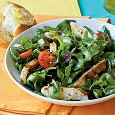 Dress up quick-cooking cutlets with a homemade vinaigrette and fresh produce for an easy Mediterranean-inspired meal.