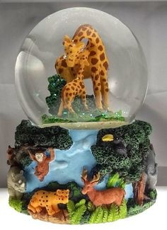 "Giraffe & Wild Jungle Animals Rotating Snow Globe - Sculptured Resin Water Ball Musical 5 3/4"" High by Sculptured Resin Snow Globes, http://www.amazon.com/dp/B006GR97P0/ref=cm_sw_r_pi_dp_zkSRpb1H77PPC"