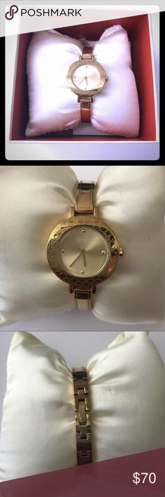 Authentic Coach Watch Beautiful Authentic Gold Tone Coach Bracelet Watch! Slight signs of wear on the back side of bangle. Bezel and glass in prefect condition. Comes with original box, additional links, and instruction booklet. Beautiful piece for any Coach lover. (Please note: Coach timepieces are manufactured by Movado) Coach Accessories Watches