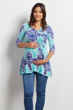 This gorgeous maternity top will be your new favorite essential this season. An elegant damask print and sash tie detail will show off your growing belly each week, and a v-neckline makes nursing after pregnancy easy. Style this top with maternity jeans and wedges for a stunning finished look