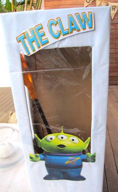 The claw game was popular too.   We made this out of a box and cellophane and filled with little gifts of a mini Toy Story character and Toy Story lolly.   We had a claw which each child used to grab for a prize.