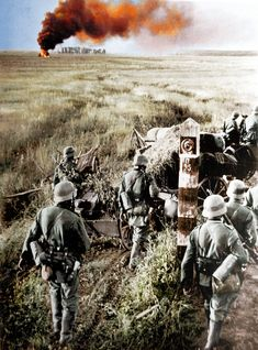 German troops crossing the Soviet border during Operation Barbarossa, as they pass among a boundary marker, 22/06/1941.