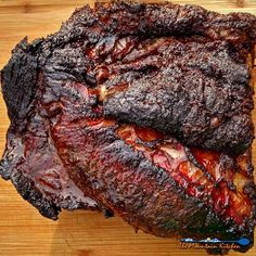 "The goal to a well smoked beef brisket is a thick moist slab of meat, a crusty ""bark"", a vivid smoke ring, and meat so smokey, it puts you in a food coma."