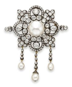 AN ANTIQUE PEARL AND DIAMOND BROOCH   Centering upon a button-shaped pearl, measuring approximately 14.80-15.20 x 11.30 mm, within an openwork old mine-cut diamond foliate plaque, suspending diamond tassels terminating with three drop-shaped pearls, measuring from approximately 6.15 to 8.60 mm, mounted in silver-topped gold, circa 1890, in a green leather fitted case