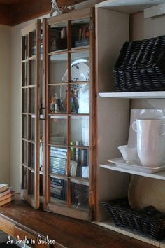 DIY Upcycled Old Window.  This is the perfect idea for storage in the dining room.