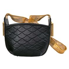 Love this shape and tight mesh shoulder strap.  rosenfeld shoulderbag | From a collection of rare vintage handbags and purses at http://www.1stdibs.com/fashion/accessories/handbags-purses/
