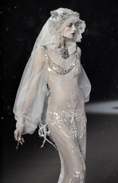 Pale bride (John Galliano Fall 09) ... a perfect dress for Lucy...