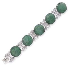 AN ART DECO JADEITE AND DIAMOND BRACELET, BY JANESICH   Designed as five carved jadeite plaques of bombé design, spaced by pavé-set diamond geometric links, mounted in platinum and 18k white gold, circa 1930, 7¼ ins., with French assay marks  Signed Janesich