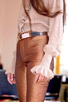 bronze-bown glitter pants and ruffled blouse