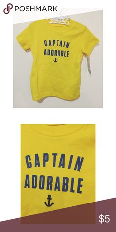 NWT 12M Carter's Unisex Captain Adorable T-shirt New with tags, yellow cotton shirt sleeve T-shirt with blue words on the chest that say Captain Adorable. Under the words is a blue embroidered anchor. Never worn. Bundle and save! Carter's Shirts & Tops Tees - Short Sleeve
