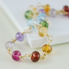A bracelet with nice, big stones in a rainbow of colours.