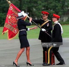 Princess Diana (1961 - 1997) presents new colours to the Light Dragoon Guards at their base in Bergen-Hohne in northern Germany, July 1995. She is wearing a Catherine Walker suit and a hat by Philip Somerville.