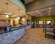 Chanhassen Family Dental. The comfortable waiting room is a perfect balance of contrasts. With the coziness of a rustic lodge mixed with the clean refinement of a state of the art clinic, this waiting room sets the tone for the patient visiting the clinic.