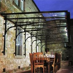 Cantilevered glass veranda canopy over dining table setting.would be a great addition to my garden or patio space.glass verandas seem to be coming more popular in uk Garden Canopy Lighting, Window Canopy, Backyard Canopy, Canopy Bedroom, Patio Canopy, Canopy Lights, Tree Canopy, Canopy Outdoor, Canopy Tent