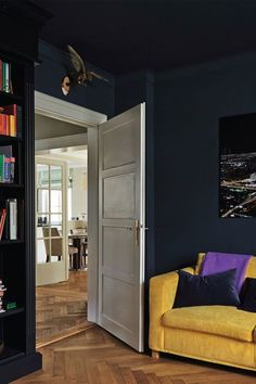 Bedroom with walls and ceiling in Hague Blue and bookshelf in Black Blue