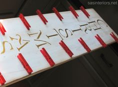 DIY: Easy-to-create Christmas Card Holder with 6' piece of wood and clothes pins by @Jenna_Burger via sasinteriors.net #LowesCreator #LowesC...