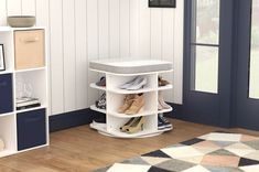 Multifunctional shoe storage is a must in the entryway or mudroom. The Revolution Storage Ottoman holds 12 pairs of shoes and offers seating so you can put on and take off your shoes right inside the door. #ShoeStorage #HomeOrganization #Entryway Revolving Shoe Rack, Rotating Shoe Rack, Boot Storage, Bench With Shoe Storage, Shoe Storage Accessories, Drop Front Shoe Box, Shoe Cubby, Take Off Your Shoes, Entryway Storage