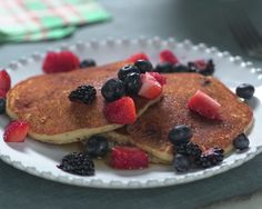 Ingredients 1 cup brown rice flour 1/3 cup almond meal 1 tablespoon cornstarch 2 teaspoons baking powder 1/2 teaspoon salt 1 cup low-fat buttermilk 2 large eggs 1 tablespoon canola oil, plus more for brushing the pan 1 tablespoon honey 1 teaspoon pure vanilla extract 2 cups mixed berries, sliced if large Pure maple syrup …