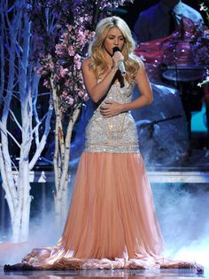 Shakira looked AMAZING at the Latin Grammys with that jewel encrusted bodice and pale peach, chiffon skirt.