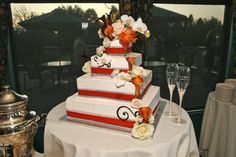 Our wedding cake, my mom has since retired from decorating but she did such lovely work! (Calla lily wedding cake, floral wedding cake, scroll wedding cake, orange wedding cake)