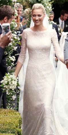 Italian aristocrat and journalist Beatrice Borromeo wore an ivory Giorgio Armani gown with princess sleeves and lace overlay to wed Princess Grace of Monaco's grandson Pierre Casiraghi on Saturday, August 1. The ceremony, took place on Italy's Borromean islands, which are owned by the bride's family.