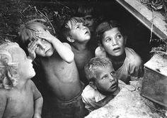 L. Konov - Terrified Russian children in Stalingrad are hiding from German bombers, 1942.