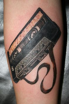 i like the idea of an old tape tattoo.