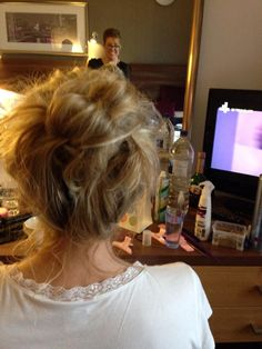 updo based on a high  loose bun