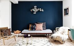 Gravity Home: Blue wall in a Copenhagen home with a black industrial kitchen