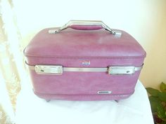 American Tourister mauve lavender orchid color with by brixiana, $40.00