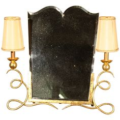 Rare Art Deco Dressing Mirror  France  1920's  An impressive Art Deco table-top dressing mirror, circa 1925, in hand-wrought gilt iron, with a nicely cut and bevelled inset mirror and two side lights with period shades.