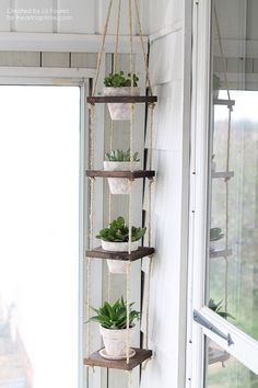 DIY Vertical Plant Hanger tutorial. This project makes a beautiful display for your potted plants without taking up a ton of room. Perfect for small balcony garden. http://hative.com/balcony-garden-design-ideas/