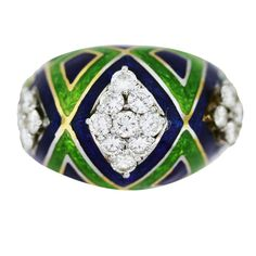"Yellow Gold Enamel Diamond Ring app 0.75 Carats unknown 1960's Beautiful Dome Ring in 18K Yellow Gold with Diamonds. Royal Blue and Parrot Green Enamel. Approximately 0.75ctw of round brilliant cut diamonds. Diamonds are G/H in color, VS in clarity. Ring is about 1/2"" wide. Size 7 and cannot be sized due to the delicate nature of enamel. The ring weighs 7.1dwt (11.1g)"